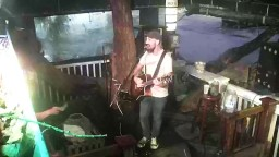Hog's Breath Saloon. USA, Florida, Key West. Musicians on stage. Webcam online.